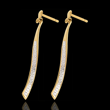 Boucles d'oreilles phénix or jaune 18 carats pavées