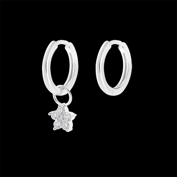 A pair of Mix earrings in 9 carat white gold