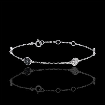 White Gold Myriad of Stars Bracelet with white diamonds and black diamonds