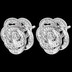 <a href=http://es.test.edenly.com/joyas/pendientes-rosas-costura,466.html><span class='nom-prod-slide'>Pendientes Frescura - Rose Dentelle - oro blanco y diamantes</span><br><span class='prixf'>$ 259</span> (-17%) </a>