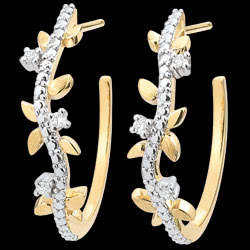 <a href=https://en.edenly.com/jewels/hoop-earrings-enchanted-garden-foliage-royal-yello,3599.html><span class='nom-prod-slide'>Hoop Earrings Enchanted Garden - Foliage Royal - yellow gold and diamonds - 9 carats</span><br><span class='prixf'>£ 289</span> (-28%) </a>