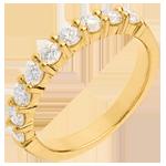 Alianza oro amarillo semi empedrado - engaste garras - 0.75 quilates - 9 diamantes