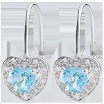 bijouteries Boucles d'oreilles Coeur Enchantement - topaze bleue - or blanc 18 carats