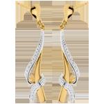 Pendientes Anudados - oro amarillo y oro blanco empedrados 18 quilates