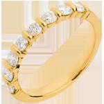 Geschenk Frauen Trauring semi pavé in Gelbgold - Krappenfassung - 0.65 Karat - 8 Diamanten