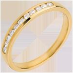 Juwelier Trauring zur Hälfte mit Diamanten besetzt in Gelbgold - Kanalfassung - 11 Diamanten
