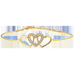 Brazalete Junco Precioso Secreto - Corazones Entrelazados - oro amarillo de 18 quilates y diamantes
