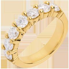 Alianza oro amarillo semi empedrado - engaste garras - 1.57 quilates - 7 diamantes