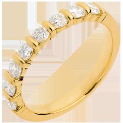 Alianza oro amarillo semi empedrado - engaste pasador - 0.65 quilates - 8 diamantes
