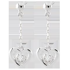 Boucle d'oreilles Coeurs pendules - or blanc 9 carats