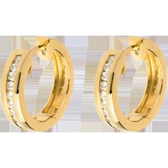Créoles or jaune diamants - serti rail - 0.24 carats - 22 diamants