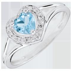 Pierścionek w kształcie serca Oczarowanie - niebieski topaz - złoto białe 18-karatowe