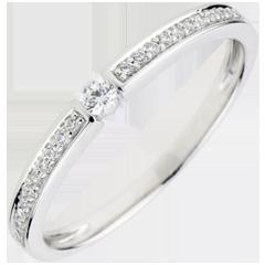 Pierścionek Ultima z jednym diamentem - diament 0,05 karata - złoto białe 9-karatowe