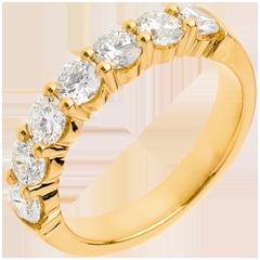 Trauring zur Hälfte mit Diamanten besetzt in Gelbgold - Krappenfassung - 1.2 Karat - 7 Diamanten