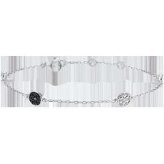 Wit gouden armband Myriade - witte diamanten en zwarte diamanten